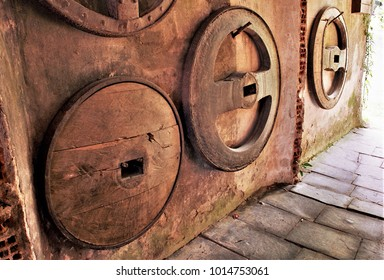 old wagon wheels from Galicia,old carpentry workshop in a Galician rural house, Galician ethnographic museum,tools of the ancient trade of carpenter and blacksmith,