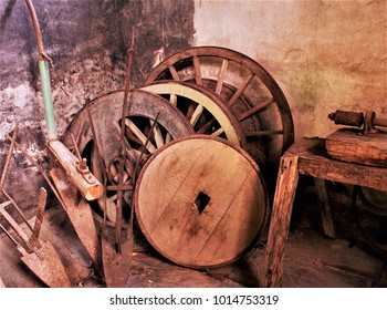 old wagon wheels from Galicia,old carpentry workshop in a Galician rural house, Galician ethnographic museum,tools of the old trade of blacksmith and carpenter and labrador