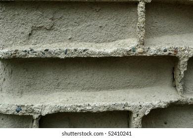 old wall with broken bricks