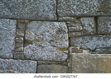 Old wall constructed from different types and sizes of stones