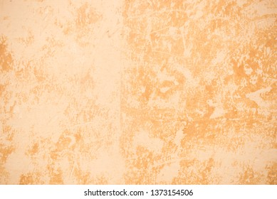 Old wall covered with two layers of cracked oil paint. Vintage retro background. Abstract textured pattern. Close-up photo