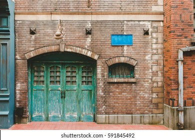 Old wall and door , Exterior steel door on brick building exterior , apartment building residential home , old door and window of brick building
