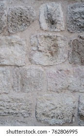 old wall of limestone architecture