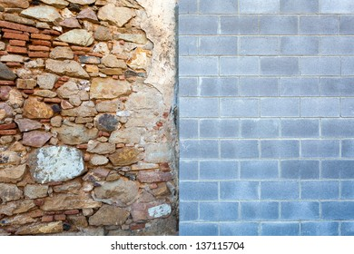An old wall meets a new one - the clash of styles conveys an interesting visual and conceptual contrast: old vs new, chaos vs order, organic vs geometric, variety vs uniformity.