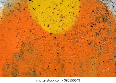 Old wall painted with red orange yellow colorful paint