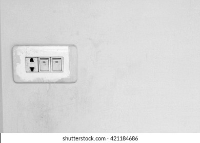 Old wall power outlet with swicth, interior design.