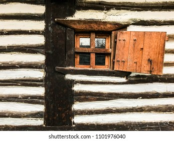 Old wall with small wooden window