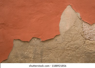 Old war with damaged plaster peeling off