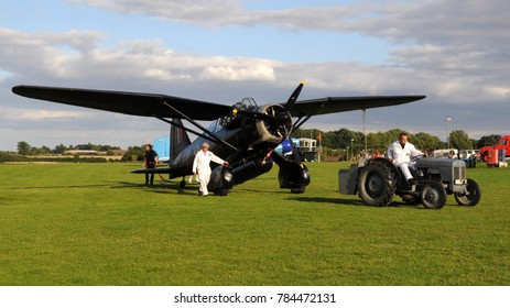 Old Warden Airfield, Beds / UK - 08/06/17: 1938 Ferguson Brown Model A tractor towing 1938 Westland Lysander in markings of 161 special duties Sqn at Shuttleworth Collction's 2017 Edwardian Pagent.