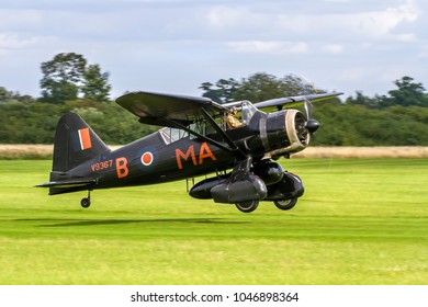 OLD WARDEN, BEDFORDSHIRE, UK – AUGUST 6, 2017: Westland Lysander IIIA V9367 G-AZWT (CN Y1536), in 161 Squadron markings, takes off to display at Shuttleworth Airfield.