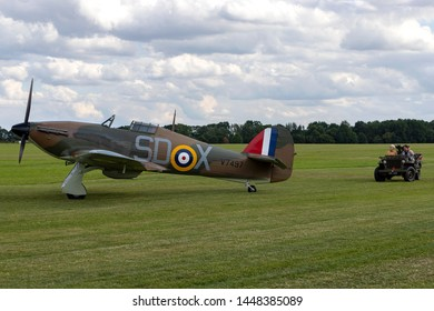 OLD WARDEN, BEDFORDSHIRE, UK – JULY 7, 2019: Almost 100 years old, Archibald McInnes is driven as guest of honour past a lineup of 7 Hurricane aircraft, the same type he flew in the Battle of Britain.