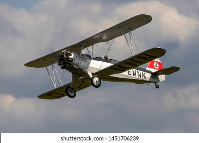 OLD WARDEN, BEDFORDSHIRE, UK – JULY 7, 2019: Focke-Wulf Fw.44J Stieglitz D-EMNN, a 1930's German two-seat biplane, carries out a display at Old Warden during the Shuttleworth Military Airshow.