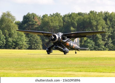 OLD WARDEN, BEDFORDSHIRE, UK – JULY 7, 2019: Westland Lysander IIIA V9367 G-AZWT (CN Y1536), in 161 Squadron markings, lands at Old Warden airfield during the Shuttleworth Military Airshow.