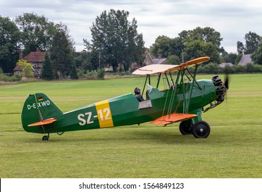OLD WARDEN, BEDFORDSHIRE, UK – JULY 7, 2019: Focke-Wulf Fw.44J Stieglitz SZ-12 (D-EXWO), a 1930's German two-seat biplane, taxis out for take off at Old Warden during the Shuttleworth Military Airshow