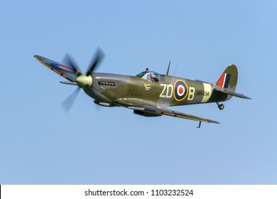 OLD WARDEN, BEDFORDSHIRE, UK – MAY 6, 2018: At the end of the day a final growl from the Merlin sees Supermarine Spitfire Mk. IXb MH434 ZD-B (G-ASJV) depart from Old Warden after the Premiere Airshow.