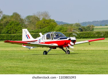 Red Airplane Moored On Airfield Stock Photo (Edit Now