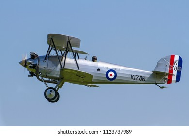 OLD WARDEN, BEDFORDSHIRE, UK – MAY 6, 2018: 1928 Hawker Tomtit K1786 G-AFTA, the sole survivor and once owned by Neville Duke, displays at Old Warden's Season Premiere & 100 Years of the RAF airshow.