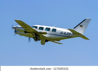 OLD WARDEN, BEDFORDSHIRE, UK – MAY 6, 2018: 1961 Piper PA-31-310 Navajo B G-ILZZ departs out of Old Warden airfield prior to the start of the Season Premiere and 100 Years of the RAF airshow.