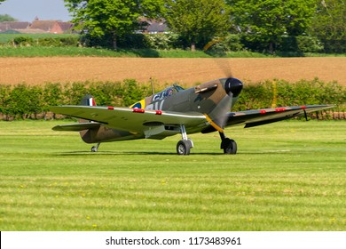 OLD WARDEN, BEDFORDSHIRE, UK – MAY 6, 2018: Supermarine Spitfire Mk I QV N3200 (G-CFGJ), recovered from Sangatte beach, takes off from Old Warden during the Season Premiere & 100 Years of RAF airshow.