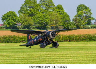 OLD WARDEN, BEDFORDSHIRE, UK – MAY 6, 2018: Westland Lysander IIIA V9367 G-AZWT, employed by No. 161 RAF Squadron on clandestine night flying operations in occupied Europe, taxis out at Old Warden.