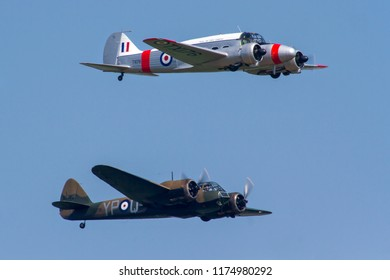 OLD WARDEN, BEDFORDSHIRE, UK – MAY 6, 2018: Avro Anson C.19 TX176 (G-AHKX) and Bristol Blenheim Mk.I YP-Q L6739 (G-BPIV) display at Old Warden  during the Premier and 100 Years of the RAF Airshow.