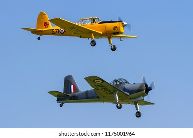 OLD WARDEN, BEDFORDSHIRE, UK – MAY 6, 2018: De Havilland Canada DHC-1 Chipmunk 22 RCAF 671 G-BNZC & Hunting (Percival) Piston Provost T.1 XF603 G-KAPW display at Old Warden during the Premier airshow.