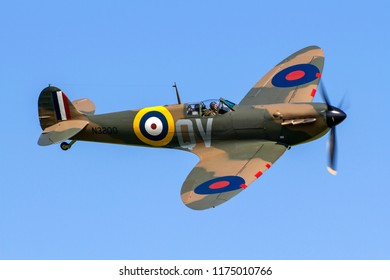 OLD WARDEN, BEDFORDSHIRE, UK – MAY 6, 2018: Supermarine Spitfire Mk I QV N3200 (G-CFGJ), recovered from Sangatte beach, displays at Old Warden during the Season Premiere & 100 Years of RAF airshow.