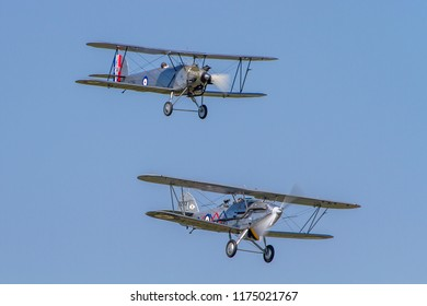 OLD WARDEN, BEDFORDSHIRE, UK – MAY 6, 2018: 1928 Hawker Tomtit K1786 (G-AFTA) and Hawker Demon 1 K8203 (G-BTVE), on display at Old Warden during the Season Premiere and 100 Years of the RAF airshow.