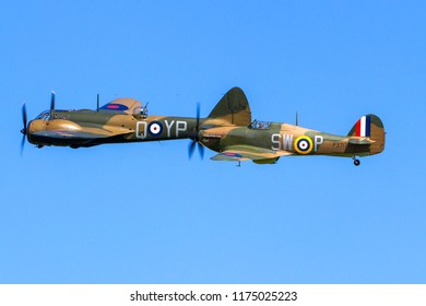 OLD WARDEN, BEDFORDSHIRE, UK – MAY 6, 2018: Hawker Hurricane Mk. I P3717 (G-HITT) escorts Bristol Blenheim Mk.I YP-Q L6739 (G-BPIV) during Old Warden's Season Premiere and 100 Years of the RAF airshow