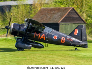 OLD WARDEN, BEDFORDSHIRE, UK – MAY 6, 2018: Westland Lysander IIIA V9367 G-AZWT, employed by No. 161 RAF Squadron on clandestine night flying operations in occupied Europe, taxis in at Old Warden.