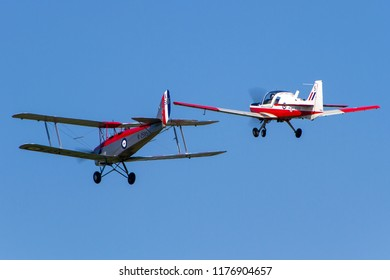 OLD WARDEN, BEDFORDSHIRE, UK – MAY 6, 2018: Avro Tutor K3241 G-AHSA & Scottish Aviation Bulldog T1 XX630 G-SIJW display together at Old Warden during the Premier and100 Years of the RAF airshow.