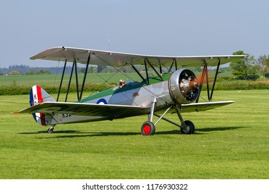 OLD WARDEN, BEDFORDSHIRE, UK – MAY 6, 2018: 1931 Avro Tutor K3241 (G-AHSA), in CFS Aerobatic team colours, taxis out at Old Warden during the Premier and100 Years of the RAF airshow.