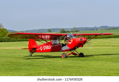 OLD WARDEN, BEDFORDSHIRE, UK – MAY 6, 2018: 1961 Piper PA-18-150 Super Cub C/N 18-7605 (G-SVAS) taxis out at Old Warden during the Premier and100 Years of the RAF airshow.