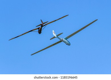OLD WARDEN, BEDFORDSHIRE, UK – MAY 6, 2018: Eon Olympia VV400 and Kirby Radar Kite gliders, carrying out a display together at Old Warden during the Season Premiere and 100 Years of the RAF airshow.