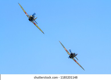 OLD WARDEN, BEDFORDSHIRE, UK – MAY 6, 2018: Hawker Hurricanes Mk. I SW-P P3717 (G-HITT) and Mk. IB 7-L Z7015 (G-BKTH) display together at Old Warden's Season Premiere and 100 Years of the RAF airshow.