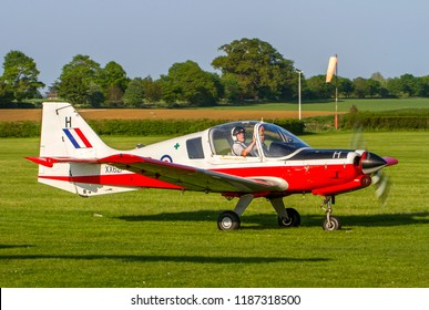 OLD WARDEN, BEDFORDSHIRE, UK – MAY 6, 2018: Scottish Aviation Bulldog T1 XX621 H (G-CBEF), maintained in RAF colours, taxis to depart out of Old Warden after their Premiere & 100 Years of RAF Airshow.