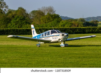 OLD WARDEN, BEDFORDSHIRE, UK – MAY 6, 2018: Piper PA-32 Cherokee Six G-CFHK, in Aerobility colours, departs out of Old Warden after their Premiere & 100 Years of RAF Airshow.