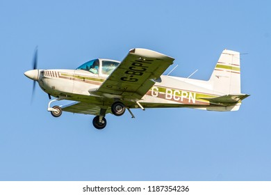OLD WARDEN, BEDFORDSHIRE, UK – MAY 6, 2018: Grumman American AA-5 Traveler G-BCPN departs out of Old Warden after their Premiere & 100 Years of RAF Airshow.