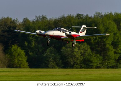 OLD WARDEN, BEDFORDSHIRE, UK – MAY 6, 2018: Piper PA-44-180 Seminole G-BGCO, operated by BAe Systems at Warton, departs out of Old Warden after their Premiere & 100 Years of RAF Airshow.