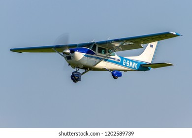 OLD WARDEN, BEDFORDSHIRE, UK – MAY 6, 2018: Cessna 182P Skylane G-BMMK departs out of Old Warden after the conclusion of the Premiere & 100 Years of RAF Centenary Airshow.