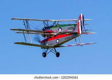 OLD WARDEN, BEDFORDSHIRE, UK – MAY 6, 2018: Avro Tutor K3241 G-AHSA & De Havilland DH-82A Tiger Moth II K2585 G-ANKT display together at Old Warden during the Premier and100 Years of the RAF airshow.