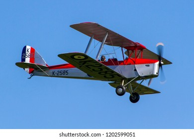 OLD WARDEN, BEDFORDSHIRE, UK – MAY 6, 2018: 1944 De Havilland DH-82A Tiger Moth II K2585 (G-ANKT), in CFS Aerobatic Team colours, at Old Warden during the Premier and100 Years of the RAF airshow.