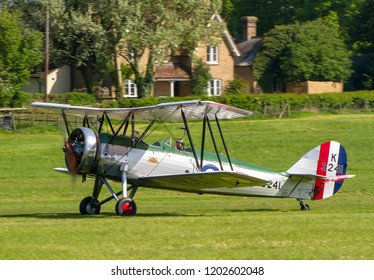 OLD WARDEN, BEDFORDSHIRE, UK – MAY 6, 2018: 1931 Avro Tutor K3241 (G-AHSA), in CFS Aerobatic team colours, taxis in after displaying at Old Warden during the Premier and100 Years of the RAF airshow.