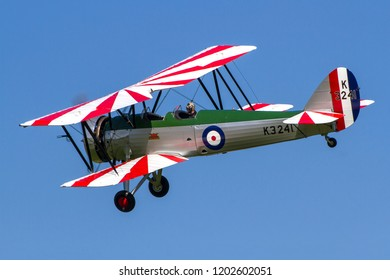 OLD WARDEN, BEDFORDSHIRE, UK – MAY 6, 2018: 1931 Avro Tutor K3241 (G-AHSA), in CFS Aerobatic team colours, displays out a display at Old Warden during the Premier and100 Years of the RAF airshow.