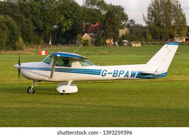 OLD WARDEN, BEDFORDSHIRE, UK – MAY 6, 2018: Cessna 150-M G-BPAW taxis out for departure from Old Warden airfield at the end of the Shuttleworth Airshow.