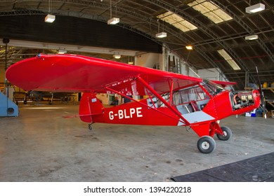 OLD WARDEN, BEDFORDSHIRE, UK – MAY 6, 2018: Piper PA-18-95 Super Cub G-BLPE undergoes maintenance work in the hangar at Old Warden, seen during the Shuttleworth Airshow.