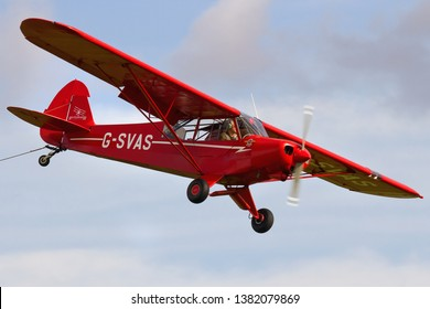 OLD WARDEN, BEDFORDSHIRE, UK – OCTOBER 5, 2014: 1961 Piper PA-18-150 Super Cub C/N 18-7605 (G-SVAS) approaches to land at Old Warden after working as a glider tug for the Shuttleworth Airshow.