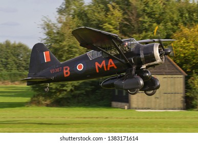 OLD WARDEN, BEDFORDSHIRE, UK – OCTOBER 5, 2014: Westland Lysander IIIA V9367 G-AZWT (CN Y1536), in 161 Squadron markings, takes off from Old Warden, about to display in the Shuttleworth Airshow.