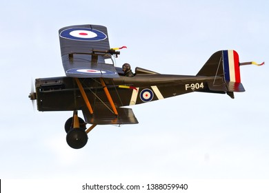 OLD WARDEN, BEDFORDSHIRE, UK – OCTOBER 5, 2014: 1917 Royal Aircraft Factory S.E.5A F904 (G-EBIA), in 84 Squadron markings, carries out a display at Old Warden Airfield, during a Shuttleworth Airshow.