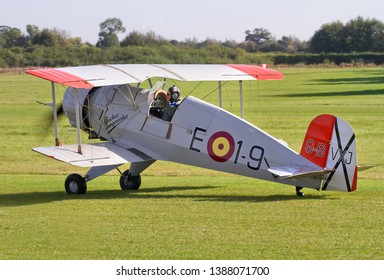 OLD WARDEN, BEDFORDSHIRE, UK – OCTOBER 5, 2014: Ex Spanish Air Force E.1-9. CASA-built, Bücker Bu-133C Jungmeister Casa 1-133C G-BVXJ, taxis in after landing at Old Warden airfield prior to a display.
